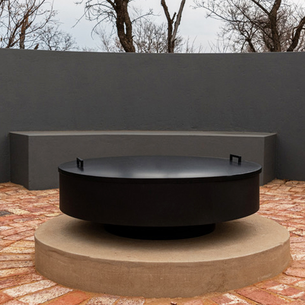 large fire pit with metal lid
